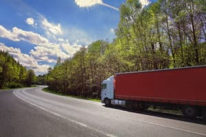 AUBURN, WA - Woman Killed when Semi-Truck Trailer Tips Over onto Car on Auburn-Black Diamond Road